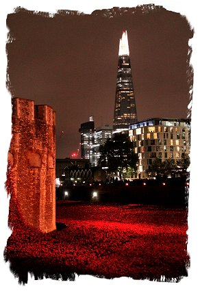 Poppies overlooked by The Shard , floodlit at the Tower of London ©vcsinden2014
