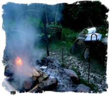 By the fire at the West wales Romany caravn from Under the Thatch. Part of The Wolf Moon Sines book for children was written here