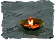 Lighted oil lamp floats on the Ganges